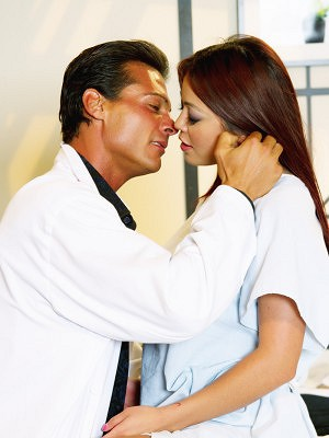 Mia Lelani is hot for her doctor Nick Manning and shows her lust by conquering his hard cock.