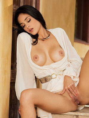 Exotic beauty Jasmine Caro slides off her clothing to reveal the most amazing body.