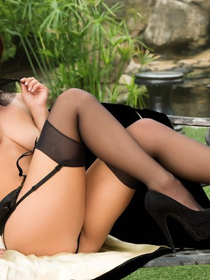 Aidra Fox shows off her stunning good looks in her lingerie and cape.